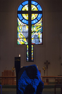 Stained glass window and baptismal font